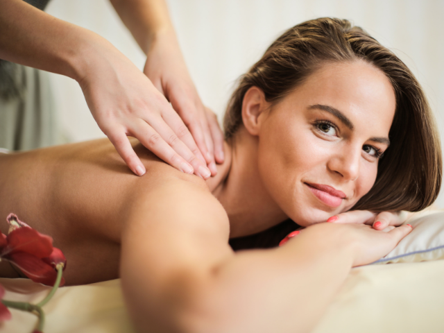Wife getting massaged by husband in exchange for giving him a massage later.  Getting massaged by a spouse can feel even better than massage therapy.